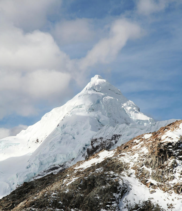 Snowcovered mountain. Snowcovered high mountain in Cordilleras royalty free stock image