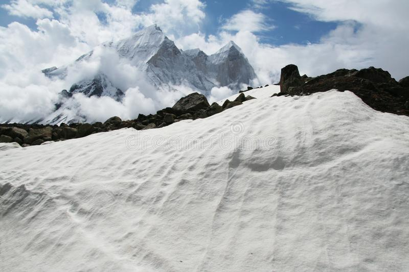 Snowcovered mountain. Snowcovered high mountain in Himalayan royalty free stock photography