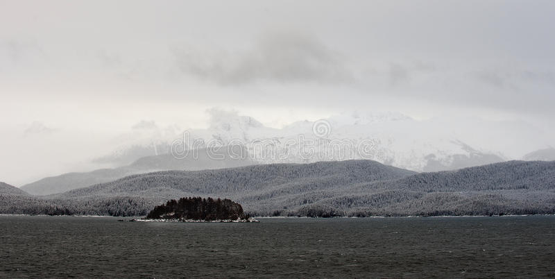 Snowcovered Mountains in Alaska. Chilkat State Park. Mud Bay. HAINES. Alaska. USA royalty free stock image