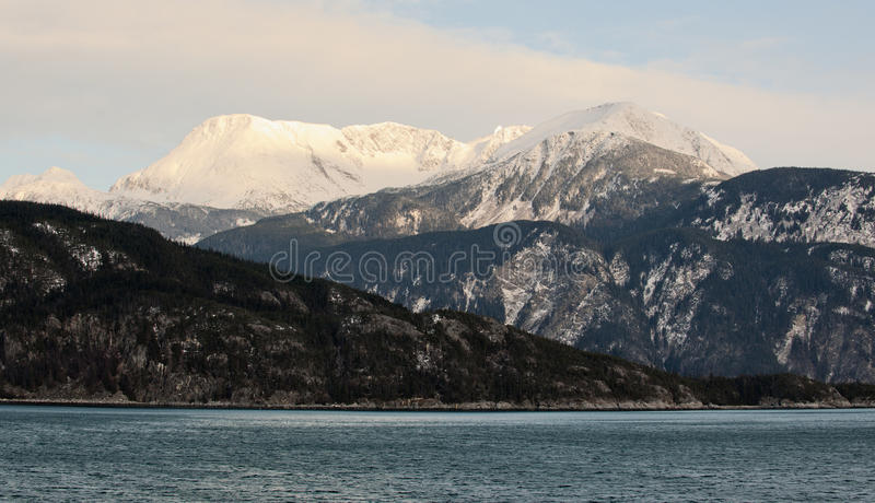 Snowcovered Mountains in Alaska. Chilkat State Park. Mud Bay. HAINES. Alaska. USA stock image
