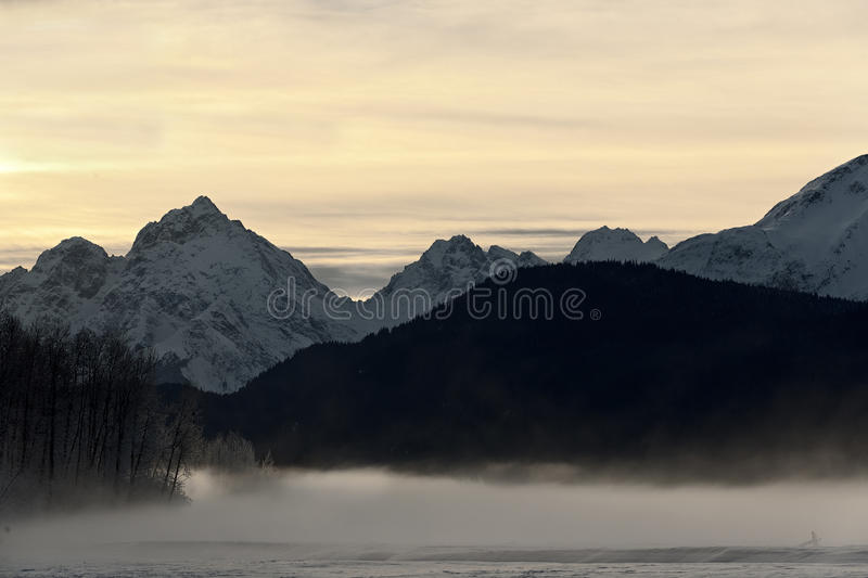 Snowcovered Mountains in Alaska. Chilkat State Park. Mud Bay. HAINES. Alaska. USA royalty free stock photography