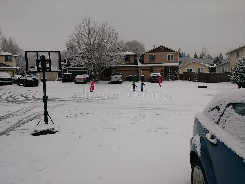 Snowday in the culdesac with the kids stock photo