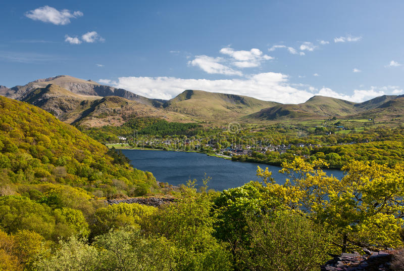 Snowdon and Llanberis. A view of Mount Snowdon, Padarn lake and the town of Llanberis.A very popular location for the tourists who visit North wales royalty free stock photo