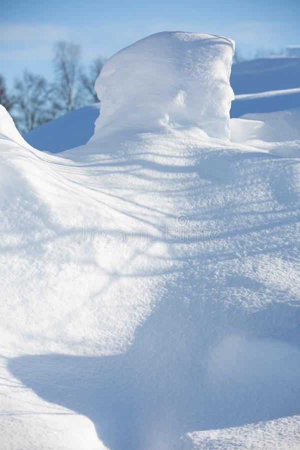 Snowdrift of the original form on a fine winter day. Close-up. Selective focus stock photo