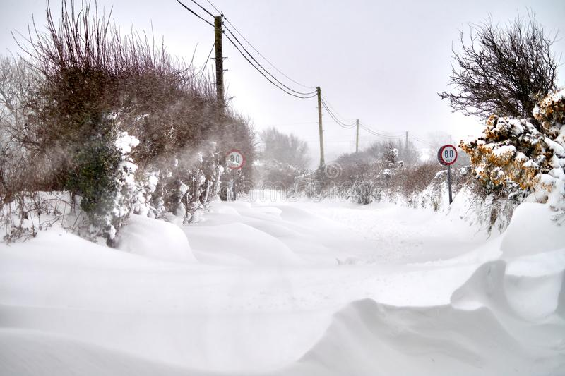 Snowdrift on the road. Extreme weather snowdrift on the road in Bannow, County Wexford, Ireland in March 2018 stock image