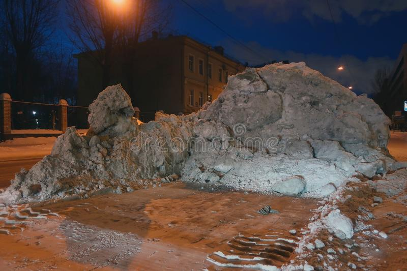Snowdrift on the side of the road royalty free stock photo