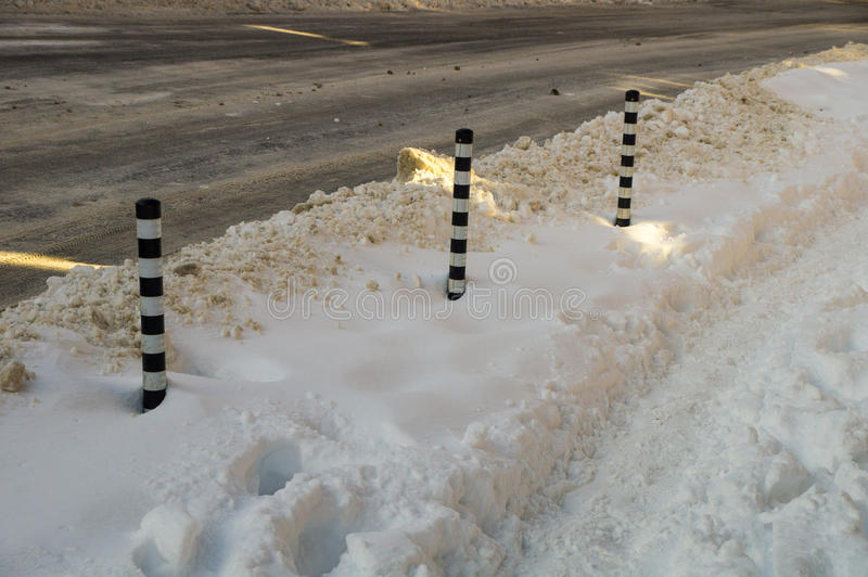 Snowdrifts around the street of columns on the street of Bulgarian Pomorie, Winter stock images