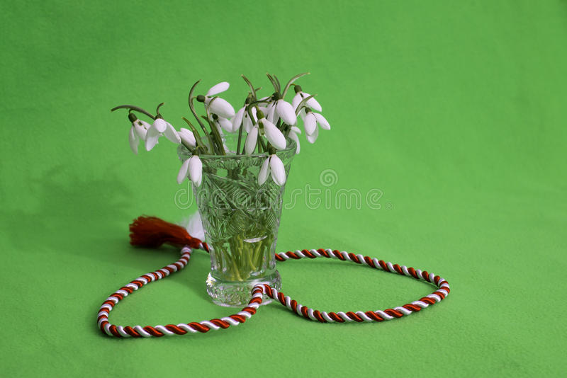 Snowdrops bouquet in crystal vase royalty free stock images
