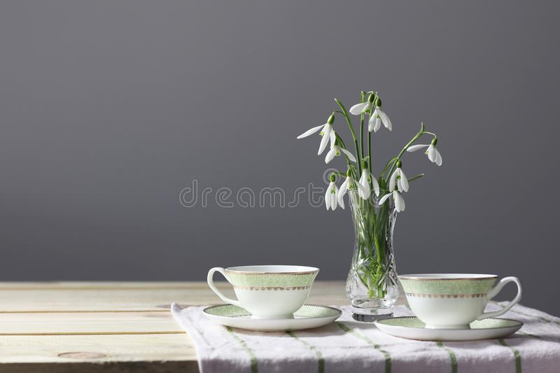 Snowdrops on the table. Spring flowers bouquet. Snowdrops background. Spring flowers on the wooden table. Holiday desk. Holiday fl royalty free stock image