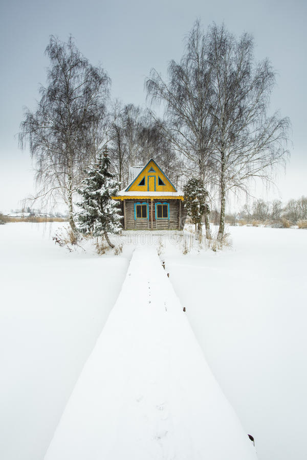 Snowed bridge to alone house in winter day. In Ukraine royalty free stock photos