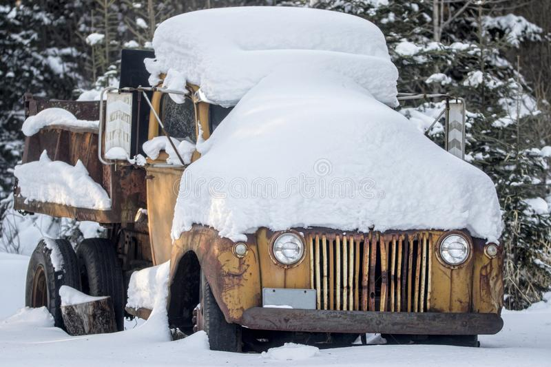 Snowed in Dump Truck. Covered in snow on a frosty morning stock photo