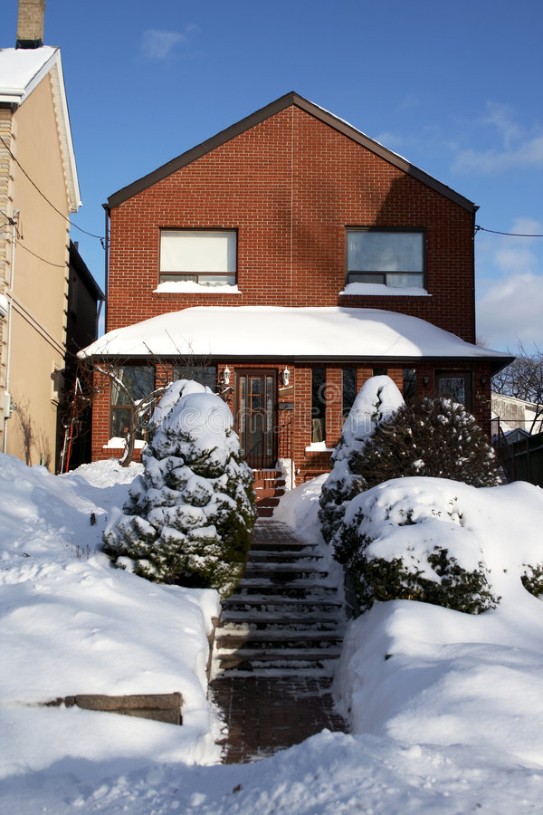 Snowed house in downtown Toronto. Snowed red-bricked house in downtown Toronto royalty free stock photos