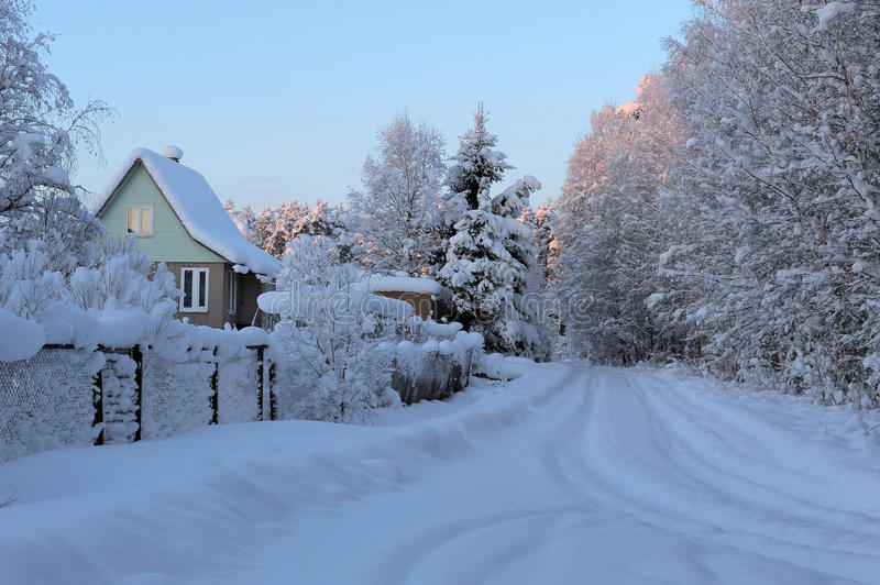 Snowed house in Russia. House (dacha) in countryside in winter. Russia royalty free stock images