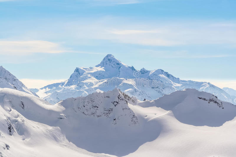 Snowed Mountain peaks in anticipation of skiers. Snowed Mountain peaks in the Caucasus in anticipation of skiers stock photography