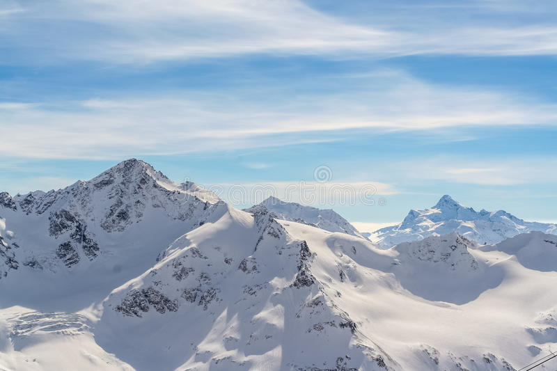 Snowed Mountain peaks in anticipation of skiers. Snowed Mountain peaks in the Caucasus in anticipation of skiers stock photo