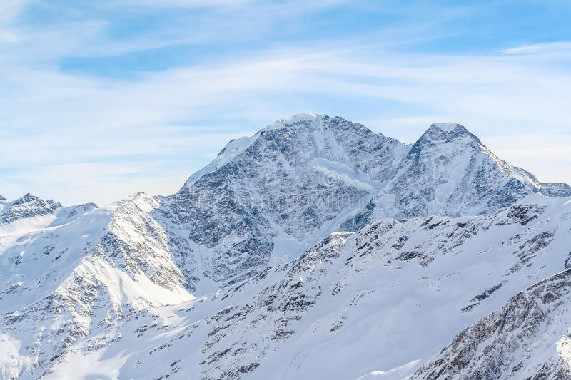 Snowed Mountain peaks in anticipation of skiers. Snowed Mountain peaks in the Caucasus in anticipation of skiers stock image