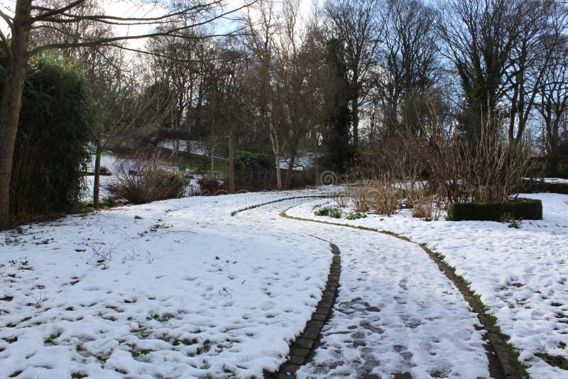 Snowed Path Public Lister Park in Bradford England royalty free stock image
