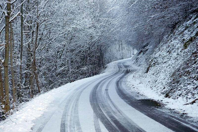 Snowed road in winter royalty free stock photography