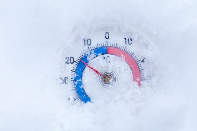 Snowed thermometer shows minus 18 Celsius degree cold winter weather concept royalty free stock photo
