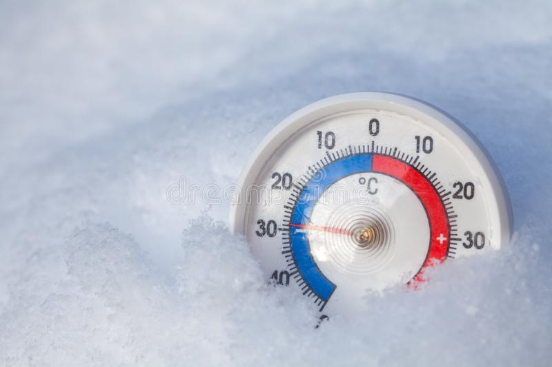 Snowed thermometer shows minus 29 Celsius degree extreme cold wi royalty free stock image