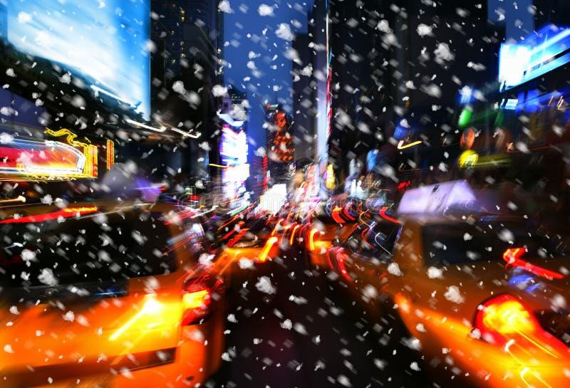 Snowfall. Illumination and night lights of New York City. Intentional motion blur royalty free stock photo