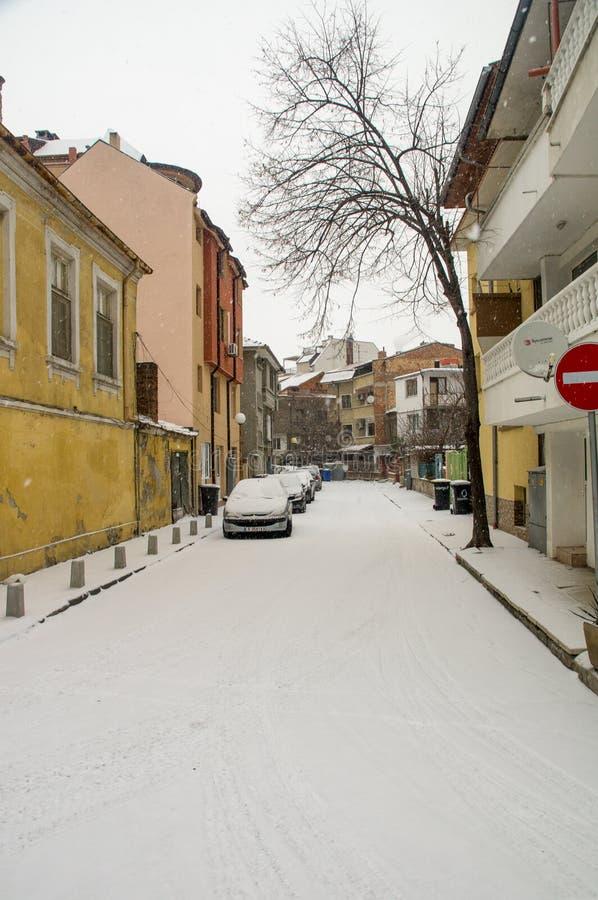 Snowfall in old street in Pomorie, Bulgaria stock photography