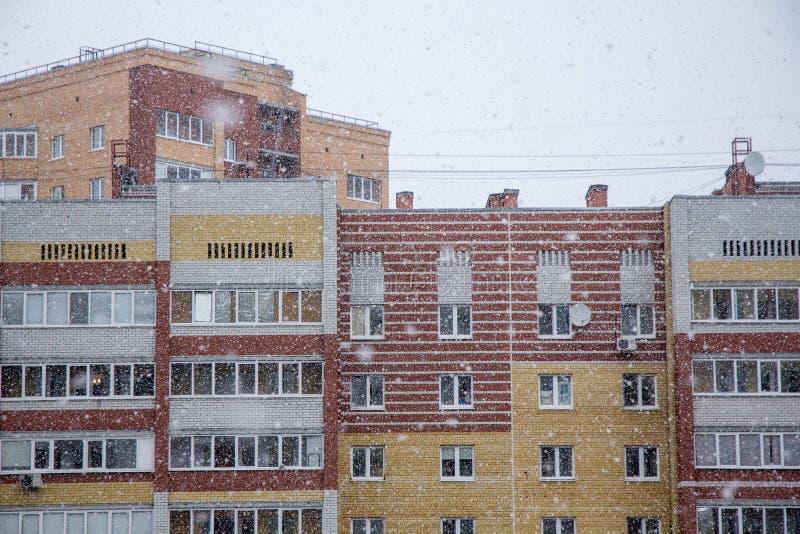 Snowfall over a city stock photography