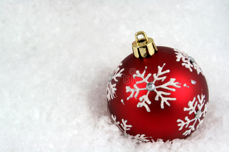 Snowflake Bauble in Snow royalty free stock photography