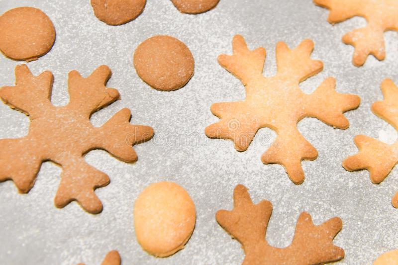 Snowflake cookies, baking on the baking sheet. Christmas gingerbread homemade. Merry Christmas card.  stock images