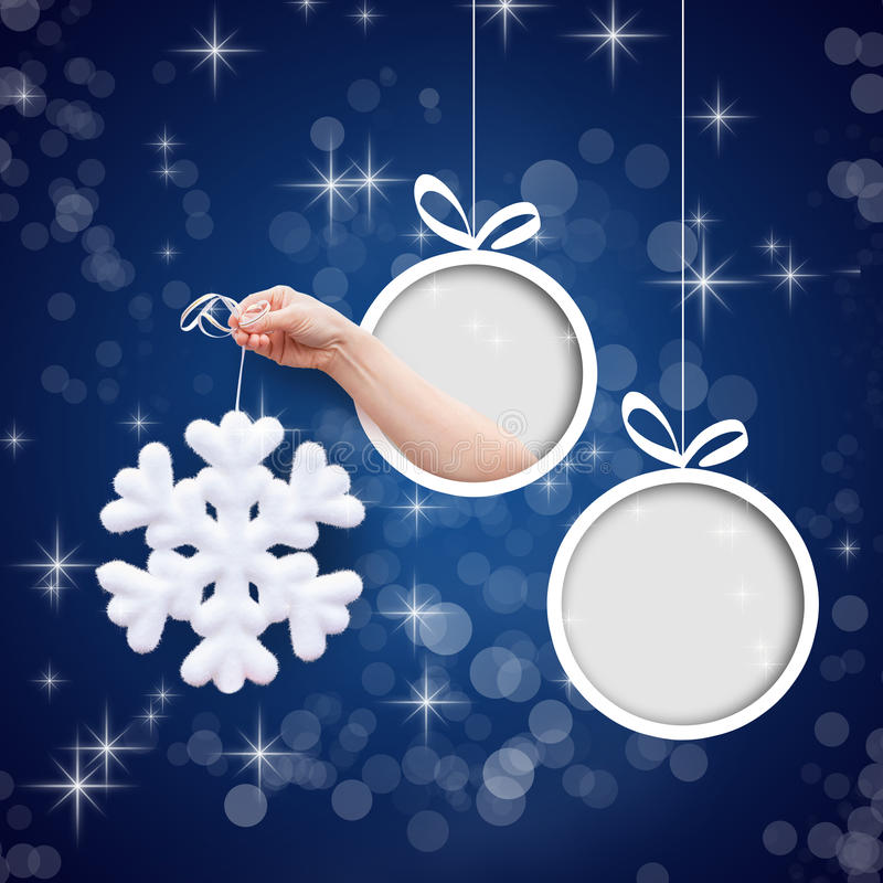 Snowflake in hand on a blue background. stock image