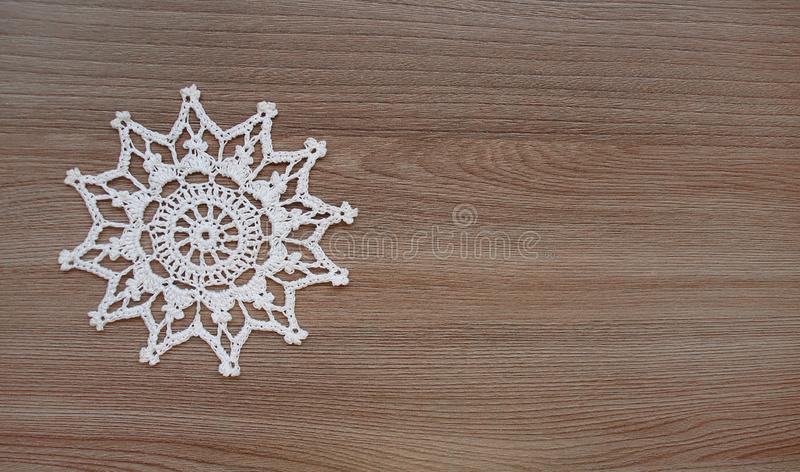 Snowflake knitted from white threads royalty free stock photos