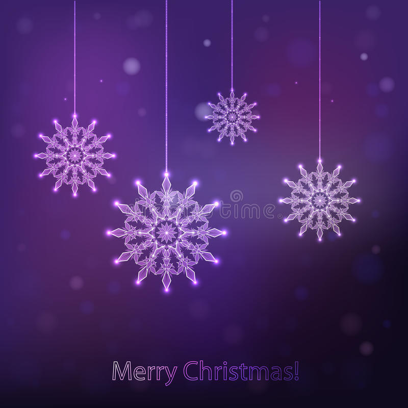 Snowflake sparkles on a dark purple background stock images