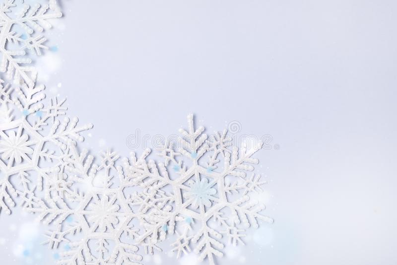 Snowflakes on Blue Background Holiday Festive Christmas Winter Concept Copy Space Top View Minimal stock photography