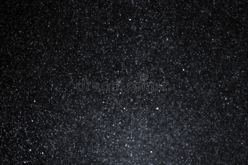 Snowflakes on dark sky royalty free stock images