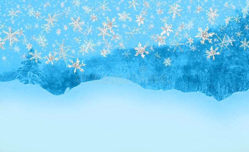 Snowflakes fall, blue background. Snowflakes fall in blue background of trees and mountain royalty free stock photos