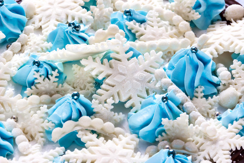 Snowflakes made from sugar paste mastic with blue cream and balls . Sugar craft fondant, cake decorating.  stock photo