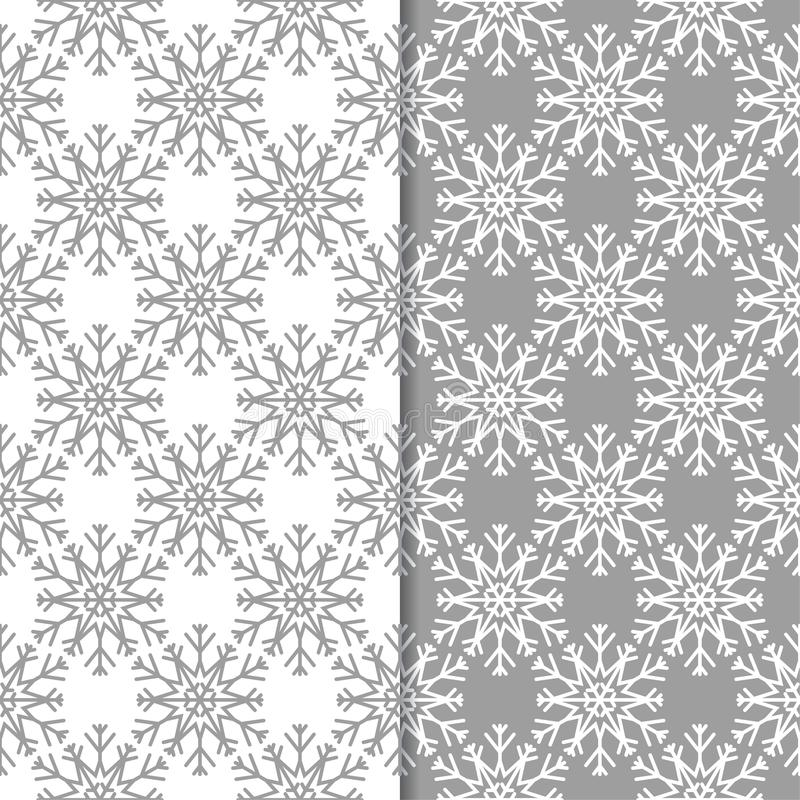 Snowflakes. Seamless patterns. Gray and white winter ornaments vector illustration