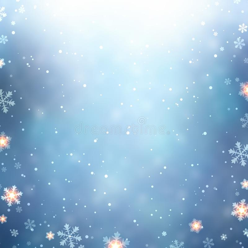 snowflakes snow and sparkles on blue winter background blurred