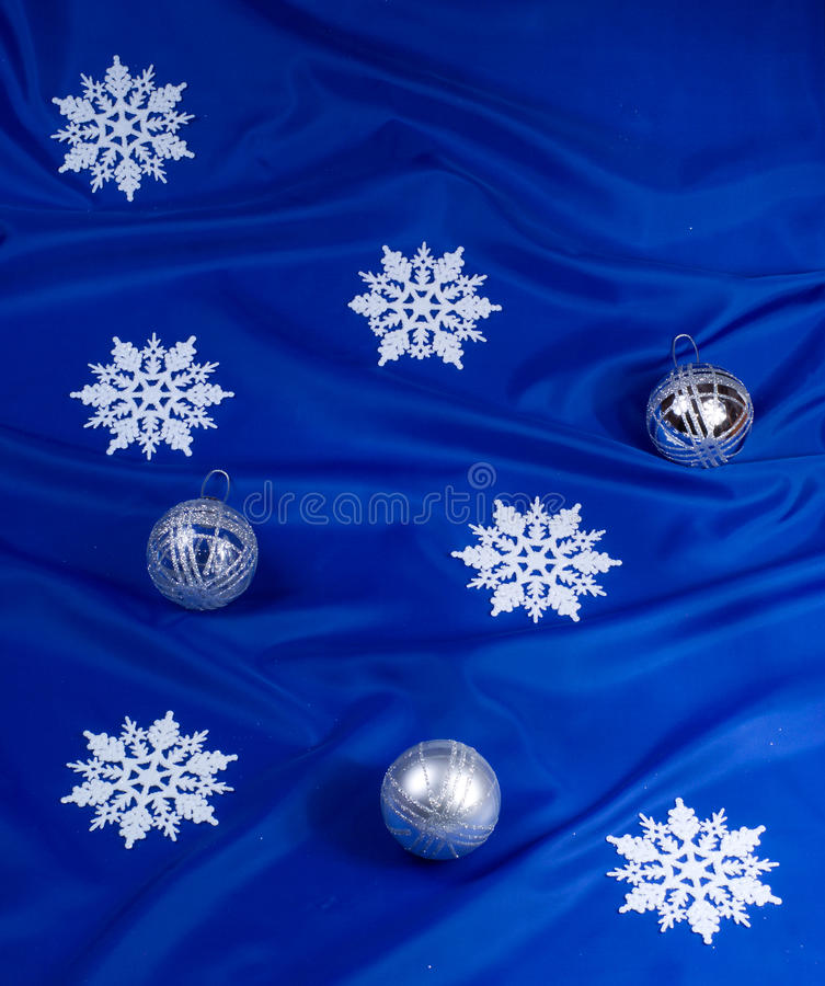 Snowflakes and spheres. On a dark blue background royalty free illustration