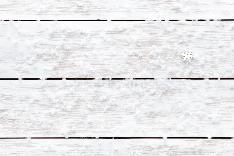 Snowflakes on wooden white empty background, merry Christmas happy New year winter holiday card, copy space, top view stock photography