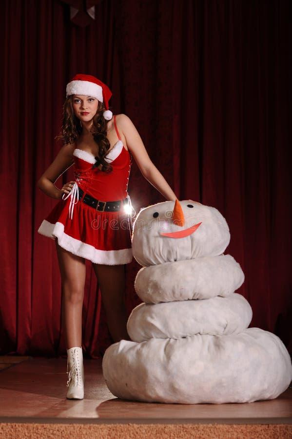 snowgirl礼服的少妇 图库摄影