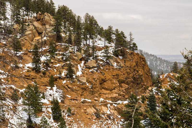 Snowing on Cheyenne Mountain Colorado Springs. Rocky mountain landscape taken while hiking through North Cheyenne Canyon in Colorado Springs during a light royalty free stock photography