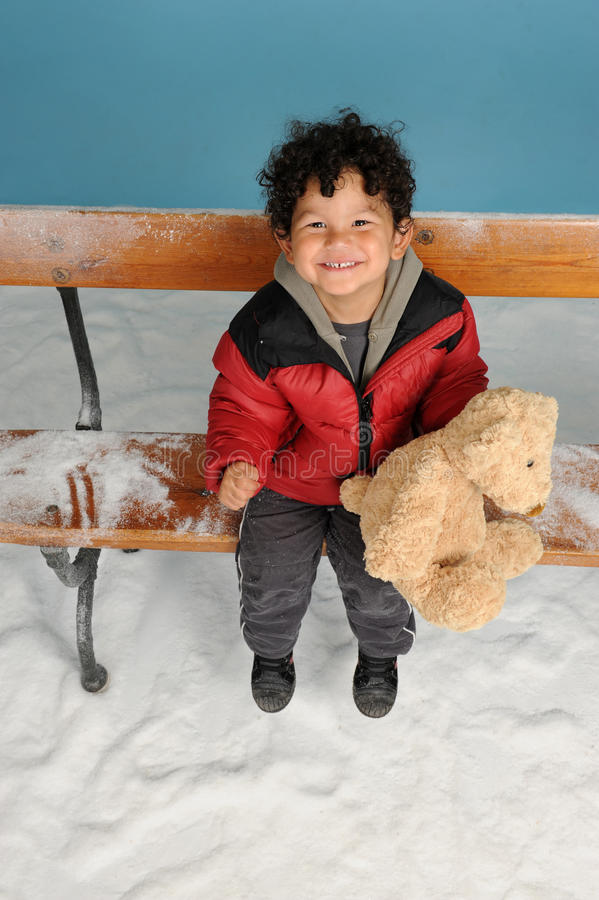Download Snowing On A Little Boy With Teddy Bear Stock Image - Image: 27425769