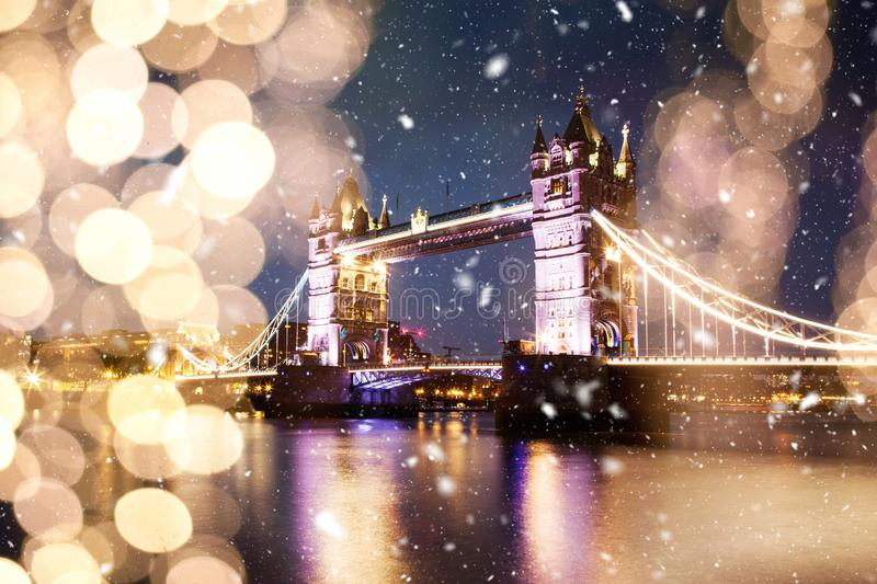 snowing in london - winter in the city stock images