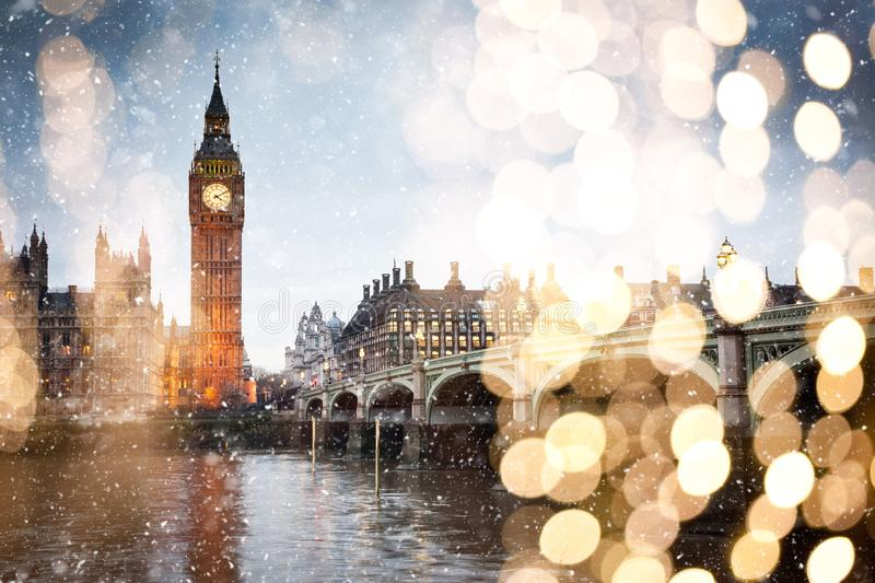 snowing in london - winter in the city stock photography