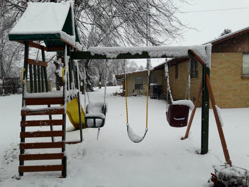SNOWING WINTER FROZEN TREE SWING stock photos