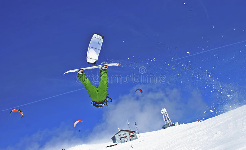 Snowkite jump. Snow kiter jump with snowboard at winter air sports 2010 stock photo