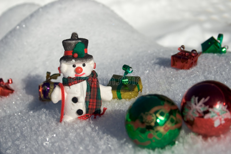 Snowman. In the snow with present royalty free stock photos