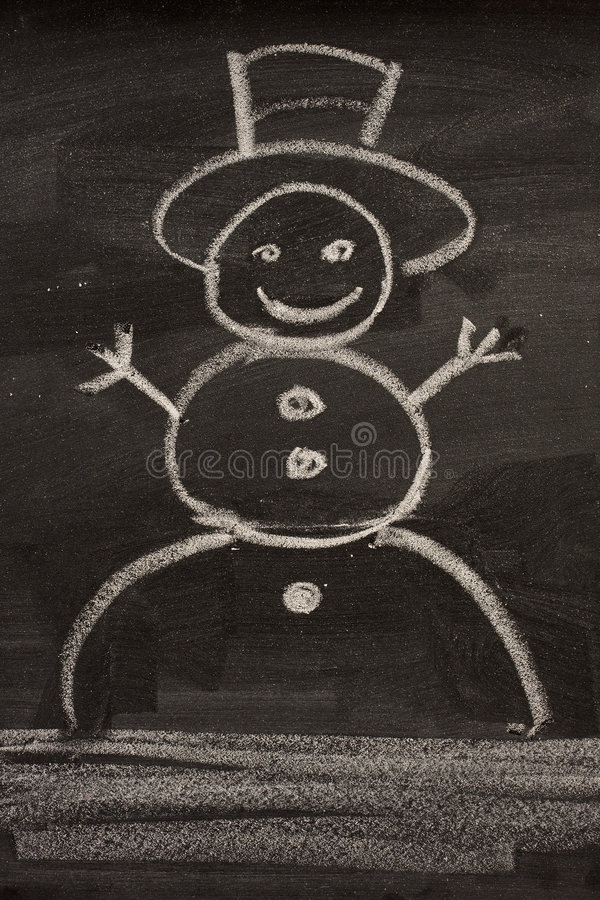 Snowman on blackboard. Snowman sketched in a child style with white chalk on blackboard stock images