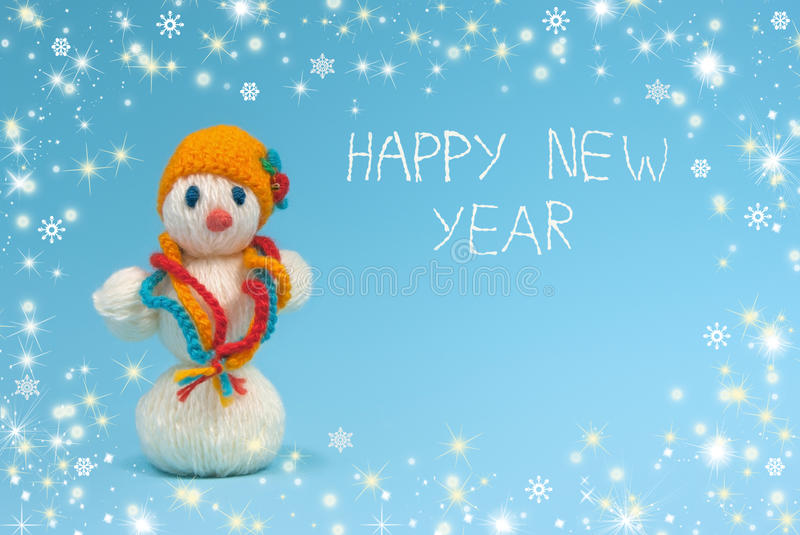 Snowman on a blue background.Happy New Year. royalty free stock image